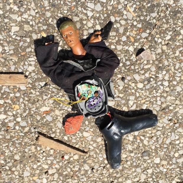 broken toy soldier on street