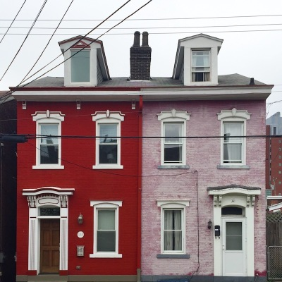 matched pair of row houses painted red and pink, Pittsburgh, PA