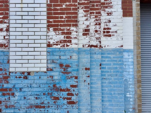 brick wall with worn paint job in several different levels, Clairton, PA