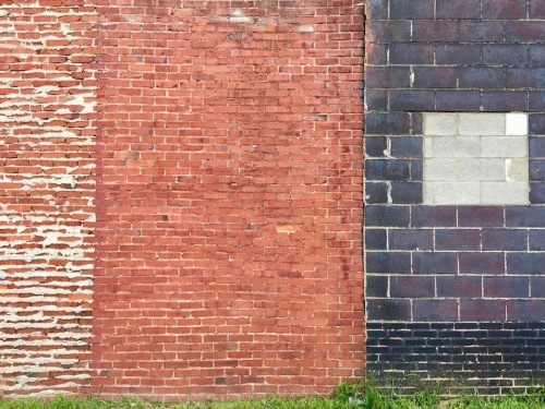 exterior wall built in multiple styles of brick and cinderblock, Clairton, PA
