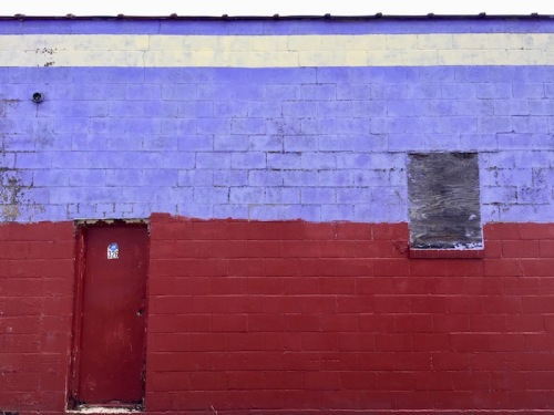 cinderblock wall painted red and blue with a white stripe, Clairton, PA