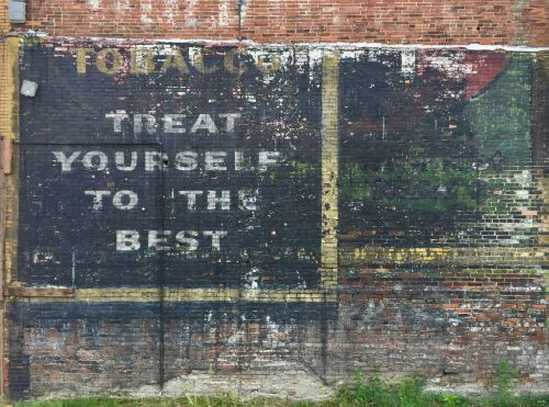 "brick with layers of ""ghost signs"" overlapping, Clairton, PA"