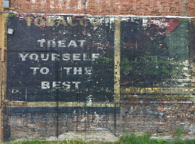"""brick with layers of """"ghost signs"""" overlapping, Clairton, PA"""