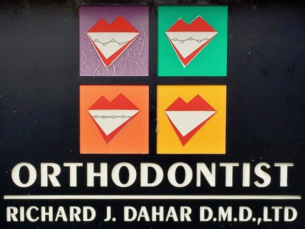 orthodontist sign with stylized images of teeth straightening, Richard J. Dahar, Avalon, PA
