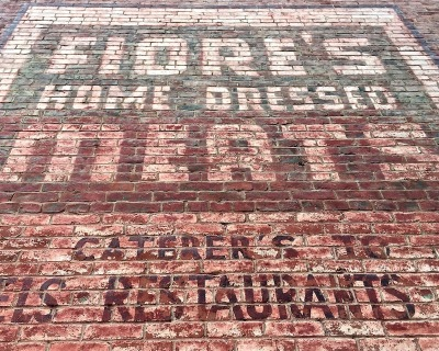 painted sign for Fiore's Home Dressed Meats on brick wall, Pittsburgh, PA