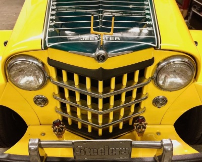 grill and hood of 1950s era Willy's Jeepster decorated in tribute to the Pittsburgh Steelers