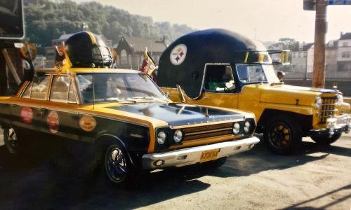 two classic cars decorated in tribute of the Pittsburgh Steelers