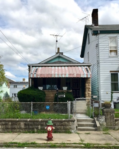 small house with tin awning and green paint, Pittsburgh, PA