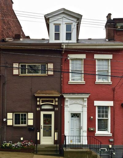 pair of matching row houses with many exterior alterations, Pittsburgh, PA