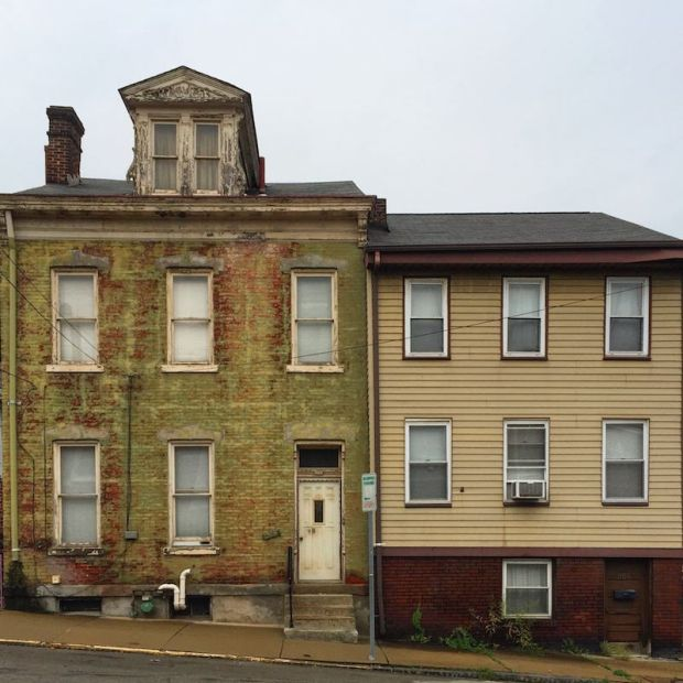 side-by-side brick and frame row houses in Pittsburgh, PA