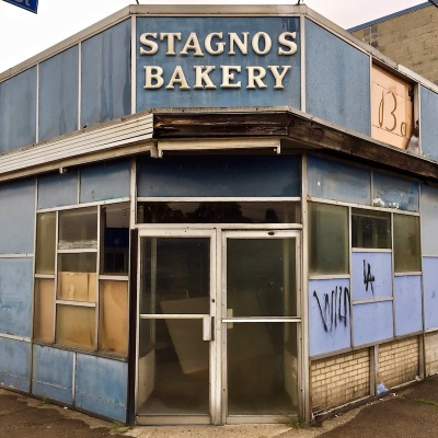 run down exterior of former retail shop for Stagno's Bakery, Pittsburgh, PA