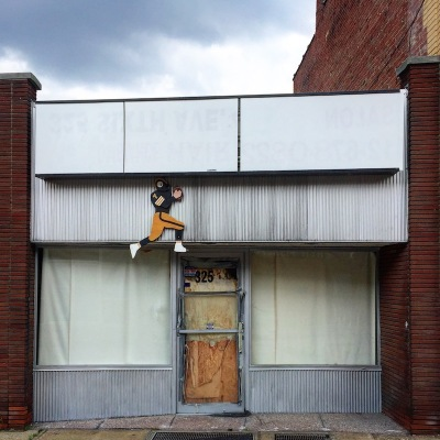 empty retail storefront with cutout of Pittsburgh Steelers football player, McKeesport, PA