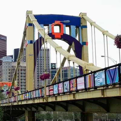 Andy Warhol Bridge in downtown Pittsburgh decorated with colorful knit panels