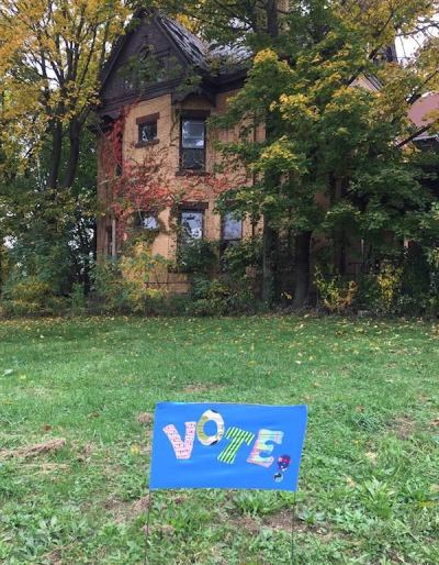"handmade ""Vote!"" yard sign in large front yard of old home in Pittsburgh, PA"