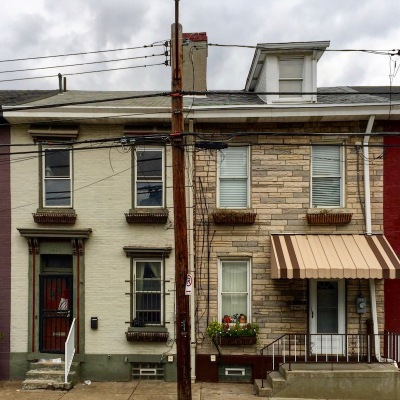 exterior of mirror-image row houses with many cosmetic differences, Pittsburgh, PA