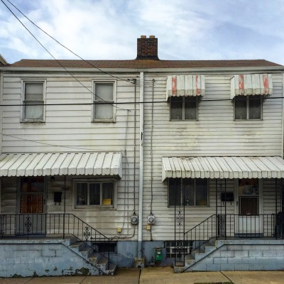 side-by-side row houses with dingy aluminum siding, Pittsburgh, PA