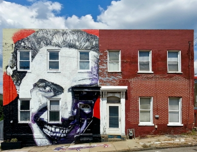 identical brick row houses, one with elaborate mural across the entire front, Pittsburgh, PA