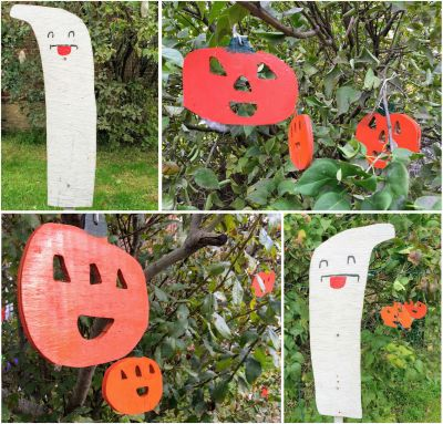wooden Halloween decorations of ghosts and jack-o-lanterns