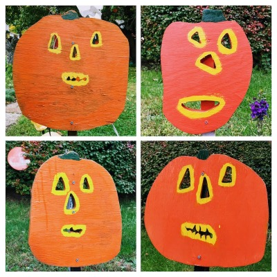 collage of four wooden Jack-o-lanterns