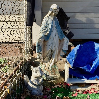 statuette of Mary in front yard of row house, McKees Rocks, PA