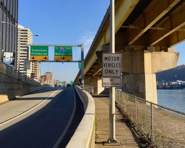 """traffic sign reading """"Motor vehicles only: no pedestrians"""" on Mon Wharf bicycle/pedestrian path in downtown Pittsburgh, PA"""