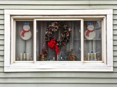 rowhouse window decorated for Christmas, Pittsburgh, PA