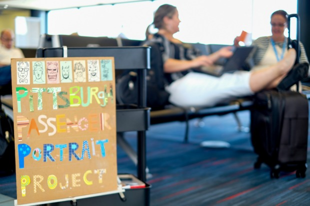 Artist Kirsten Ervin with portrait subject at Pittsburgh International Airport