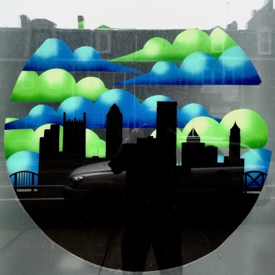 storefront window image including Pittsburgh skyline