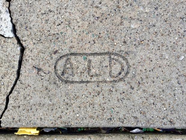 mason's sidewalk stamp in cracked concrete, Sharpsburg, PA