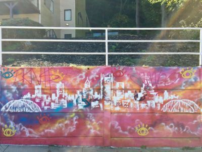 mural of downtown Pittsburgh skyline by artist Baron Batch
