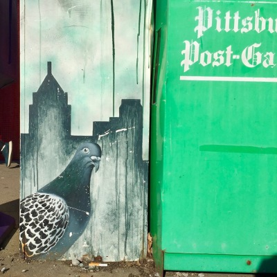 news box with artwork of Pittsburgh skyline and pigeon