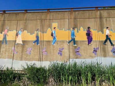 mural including the Pittsburgh skyline along bicycle trail