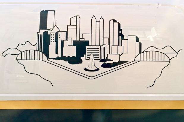 line drawing of Pittsburgh skyline on police van