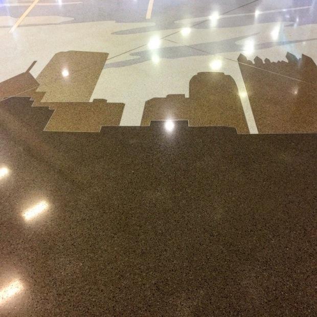 terrazzo tile floor of Pittsburgh International Airport with rendering of Pittsburgh skyline