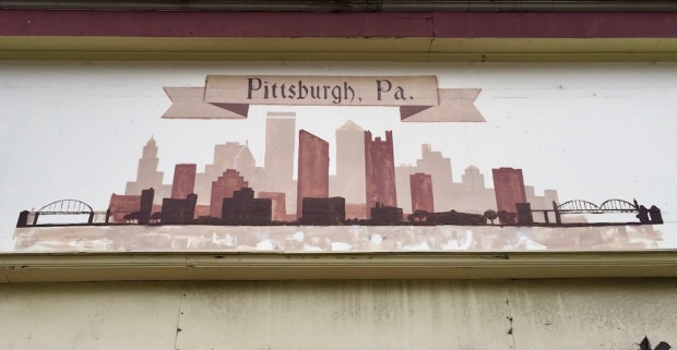 painting of Pittsburgh skyline on retail storefront