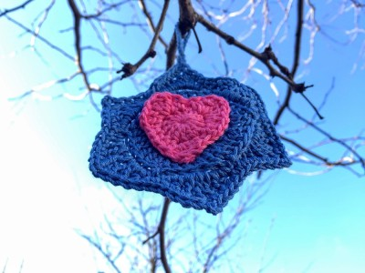 crochet Star of David with heart hanging from tree limb, Pittsburgh, PA