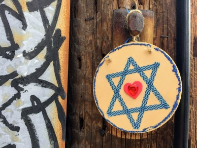 wooden disc with Star of David hanging on utility pole, Pittsburgh, PA