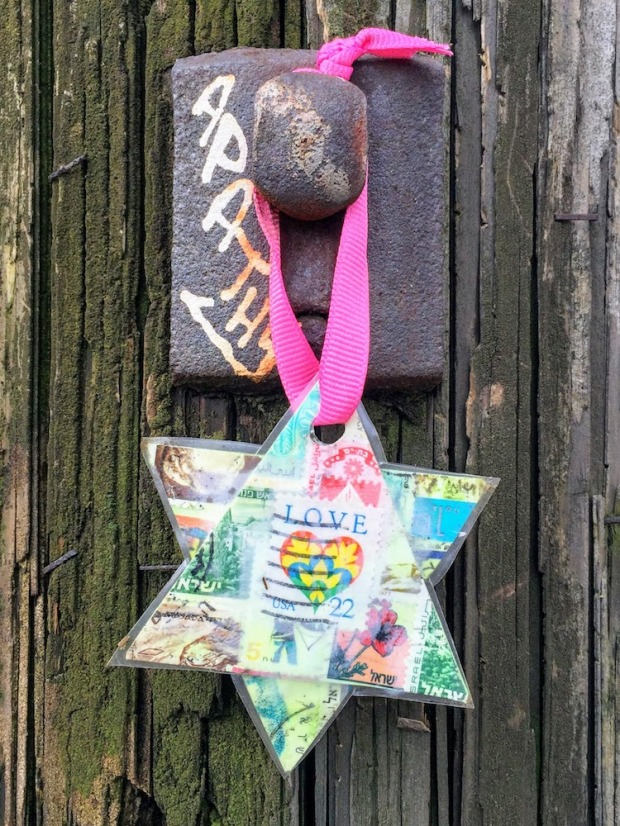 Star of David made from postage stamps hanging on utility pole, Pittsburgh, PA