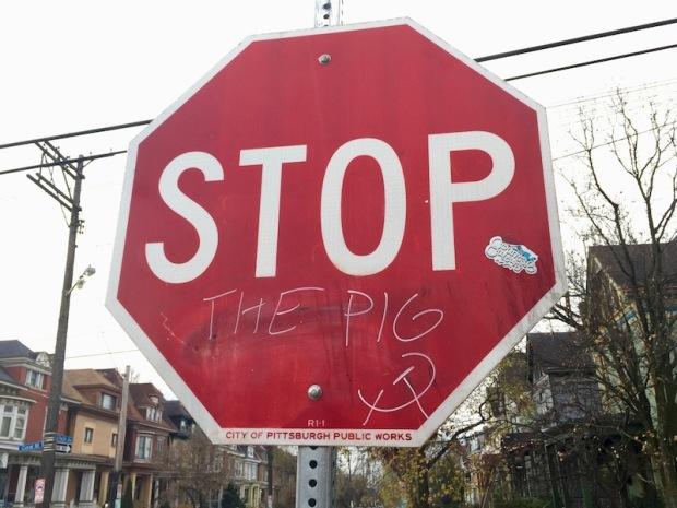 """stop sign with graffiti addition of """"the pig,"""" Pittsburgh, PA"""