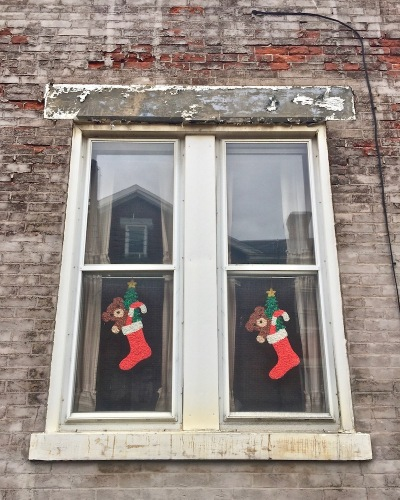 windows decorated with Christmas stockings, Pittsburgh, PA