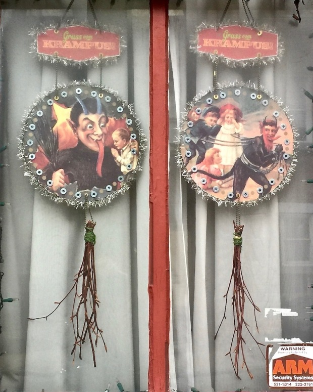 Krampus holiday decorations in row house window, Pittsburgh, PA