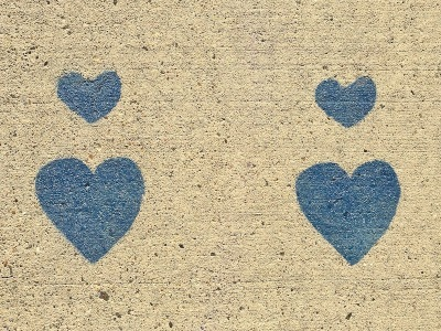 blue hearts stenciled on concrete sidewalk