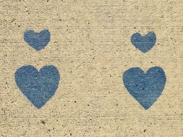 blue hearts stenciled on concrete sidewalk