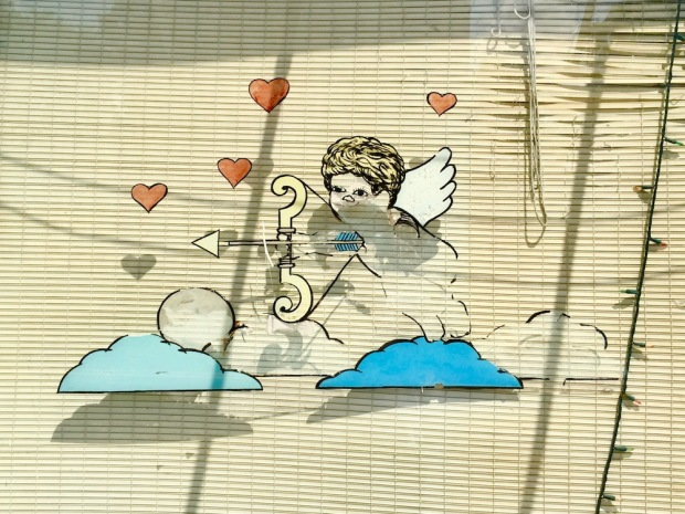 hand painted window image of Cupid in retail store front window, Clairton, PA