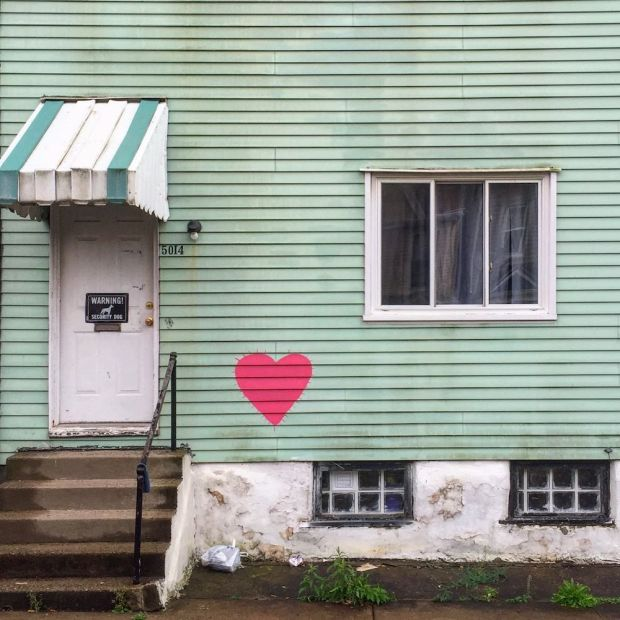 wood frame house with red heart painted on green siding, Pittsburgh, PA