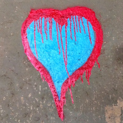graffiti image of heart painted on cement wall