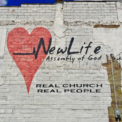painted sign for New Life Assembly of God church on side of building, Brownsville, PA