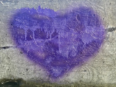 purple heart graffiti on concrete wall