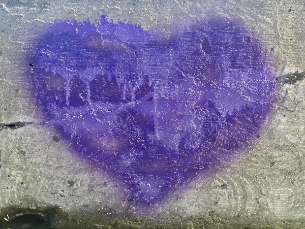 purple heart graffiti on concrete wall