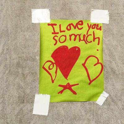 """message taped to wall reading """"I love you so much"""""""